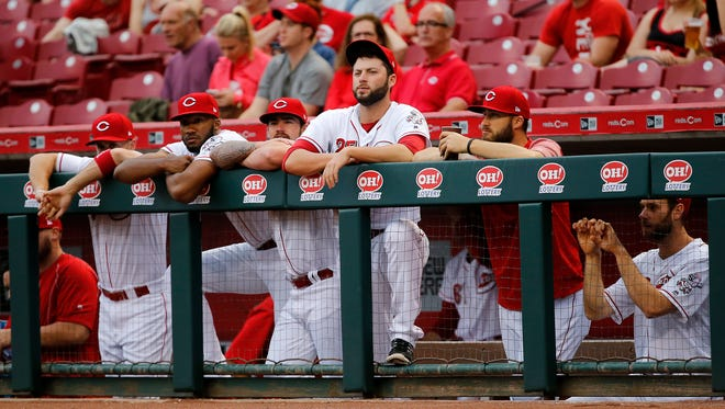 From left: Cincinnati Reds right fielder Patrick Kivlehan (3), starting pitcher Amir Garrett (50), starting pitcher Brandon Finnegan (29), pitcher Cody Reed (25), pitcher Tim Adleman (46) and relief pitcher Tony Cingrani (52) watch the interleague baseball game between the Baltimore Orioles and the Cincinnati Reds, Thursday, April 20, 2017, at Great American Ball Park in Cincinnati.