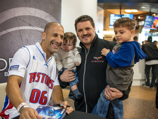 IndyCar driver Tony Kanaan meets with young fans at Grand Prix Night with the Detroit Pistons.