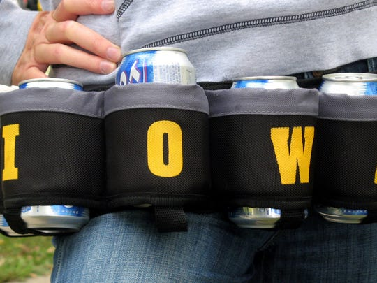 "An Iowa fan wears a ""Hops Holder"" while tailgating"