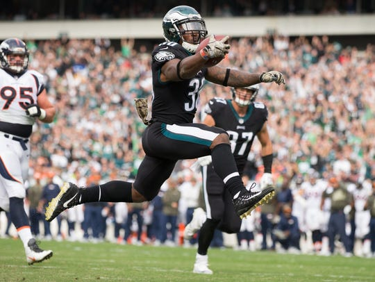 Eagles running back Corey Clement leaps into the end