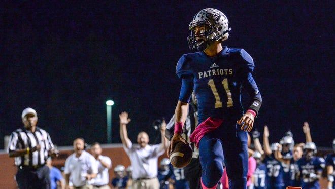Powdersville quarterback Keith Becknell (11) runs in a touchdown during the first quarter at Powdersville High School on Friday.