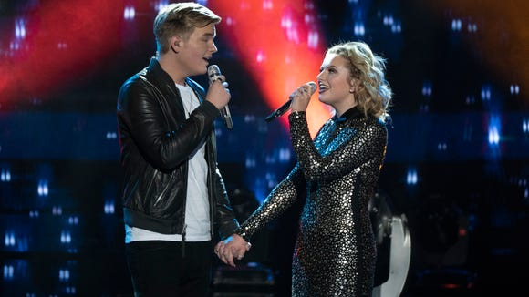 """Caleb Lee Hutchinson and Maddie Poppe perform on the season finale of """"American Idol"""" in Los Angeles."""