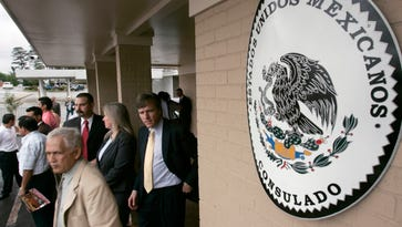 Visitors walk from the Mexican Consulate in Little Rock, Ark., after the grand opening of the building in 2007. The Mexican government on Thursday Jan. 15, 2015 will start issuing birth certificates to its citizens at consulates in the United States, seeking to make it easier for them to apply for U.S. work permits, driver's licenses and protection from deportation.