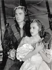 Errol Flynn and Olivia de Havilland in a scene from