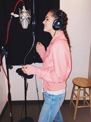 In a New York recording studio, Maddie Fidler, professionaly