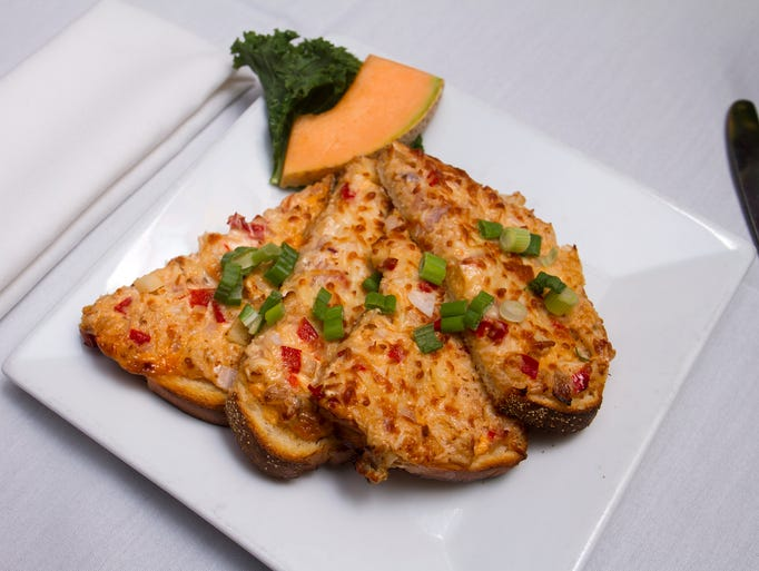 Crab spread with parmesan toasted is a specialty bruschetta