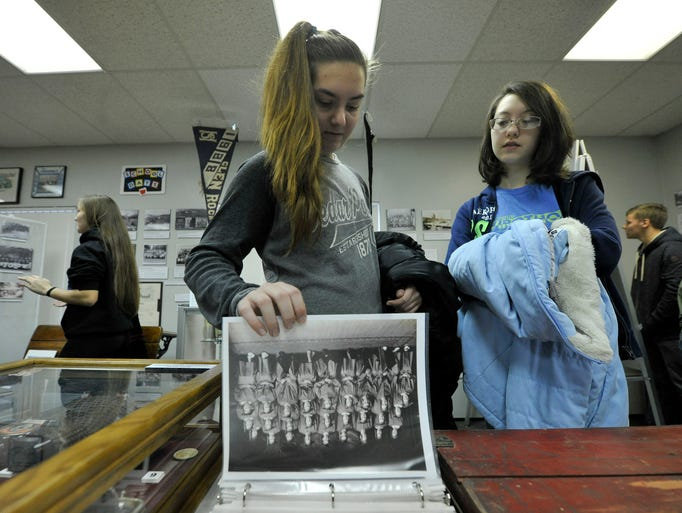 Kate Cramer, left, and Angelica Hunt, looks through