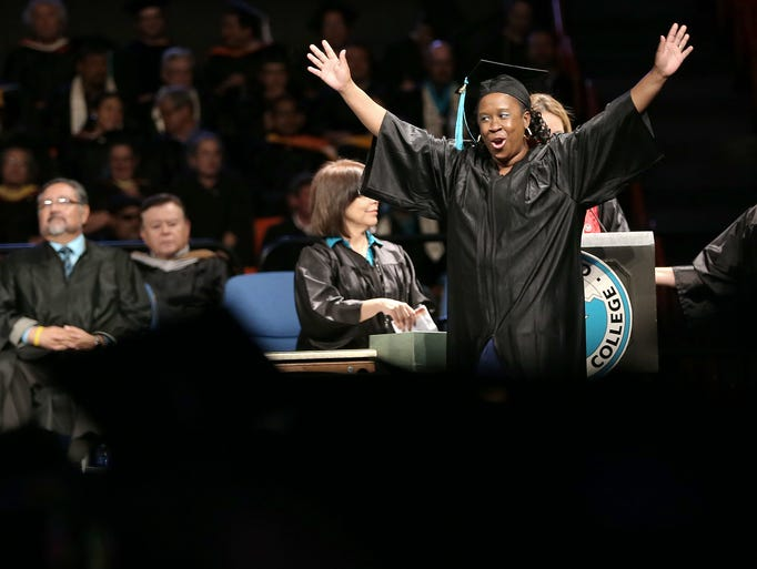 Andrea Richardson celebrates as she crosses the stage