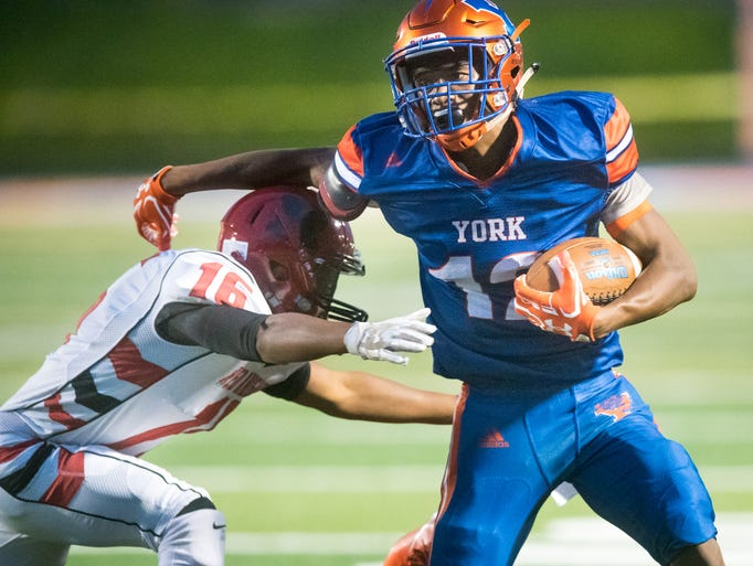 York High's Robert Rideout looks to break a tackle