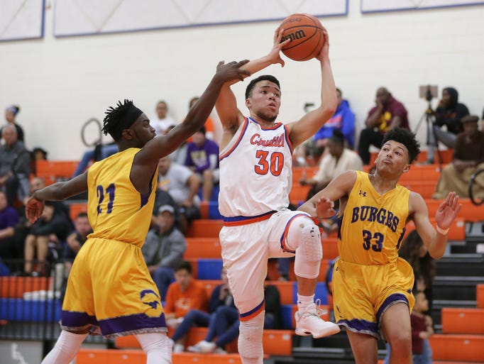 Canutillo's Alex Monreal is defended by Burges's Larry