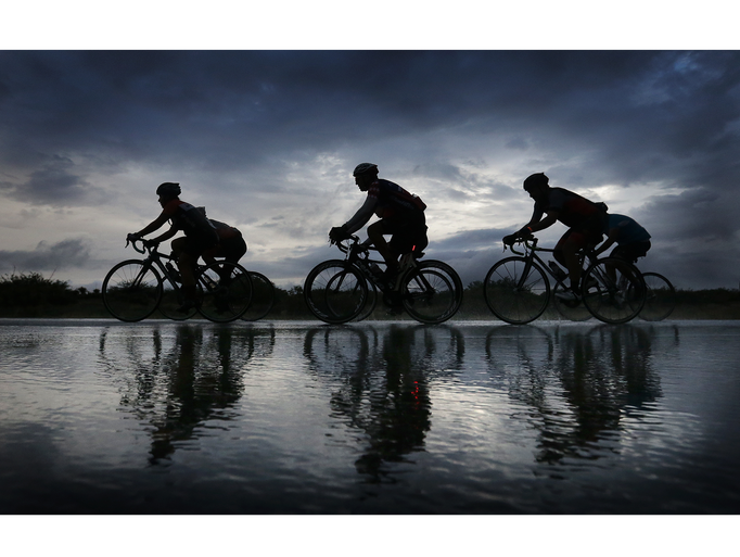 Cyclists endure a downpour Sunday as they ride in the