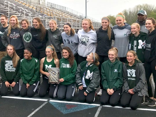 Madison's girls team celebrates its title in Friday's Ohio Cardinal Conference track meet.