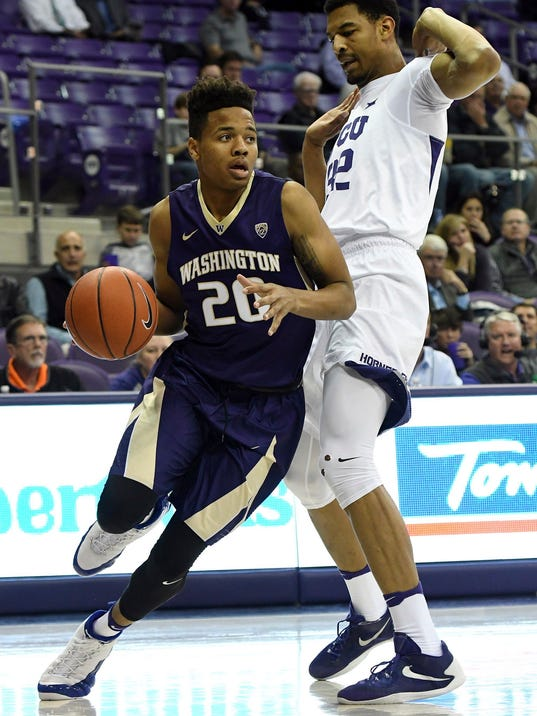 Washington's Markelle Fultz, left, drives to the basket against TCU's Karviar Shepherd during the first half of an NCAA college basketball game Wednesday, No. 30, 2016, in Fort Worth, Texas. (Bob Haynes/Star-Telegram via AP)