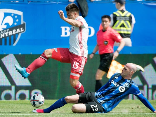Montreal Impact's Laurent Ciman, right, challenges Atlanta United's Hector Villalba during first half of an MLS soccer game in Montreal, Saturday, April 15, 2017. (Graham Hughes/The Canadian Press via AP)