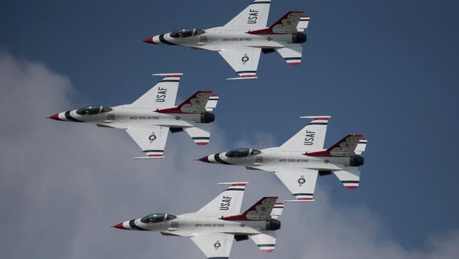 The USAF Thunderbirds perform their final day at AirVenture air show August 3, 2014.