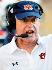 Auburn offensive line coach J.B. Grimes yells a 2015 college football game at LSU. LSU defeated Auburn Tigers 45-21. Grimes has accepted the offensive line coach position at Cincinnati under head coach Tommy Tuberville.