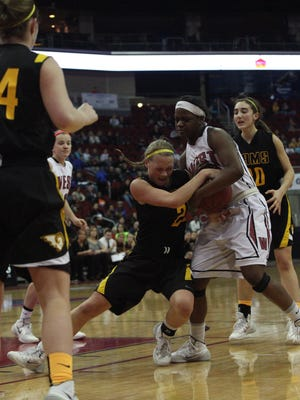Southeast Polk junior Jacey Huinker fights for a rebound with Waterloo West's Blaire Thomas. Southeast Polk beat Waterloo West 54-46 in a semifinal game Friday at the Class 5-A state girls' basketball tournament at Wells Fargo Arena. March 7, 2014.