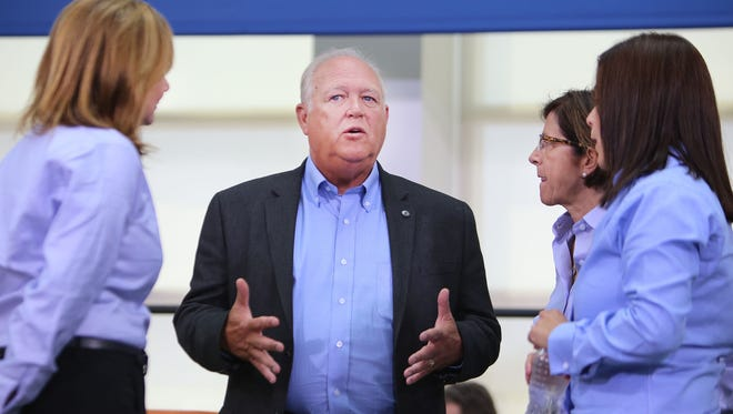 Following the ceremonial handshake between General Motors and United Auto Workers Monday, July 13, 2015 at the UAW-GM Center for Human Resources in Detroit, UAW President Dennis Williams, center, talks as General Motors President  Mary Barra, left,  listens along with   General Motors North America Vice-President Cathy Clegg, second from right,  and UAW Vice-President for General Motors Cindy Estrada.