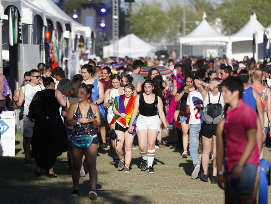 Pride attendees make their way among the vendors during