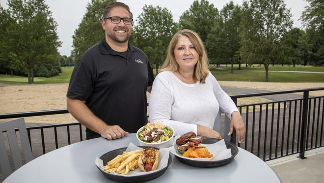 Milo's Grill owners Louie Pappas and Demetra Stefanidis pose with some of their selections on the patio outside the Champions Golf Course clubhouse on the Northeast Side. Their other businesses, Milo's Cafe and Milo's Catering, have taken a hit during the coronavirus pandemic, but they are feeling like they found a diamond in the rough with the golf course grill.