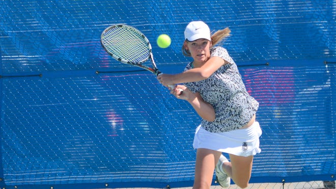 Centennial's Christa Alberson returns a volley in the District 3-6A girls doubles finals Monday at Carlsbad.