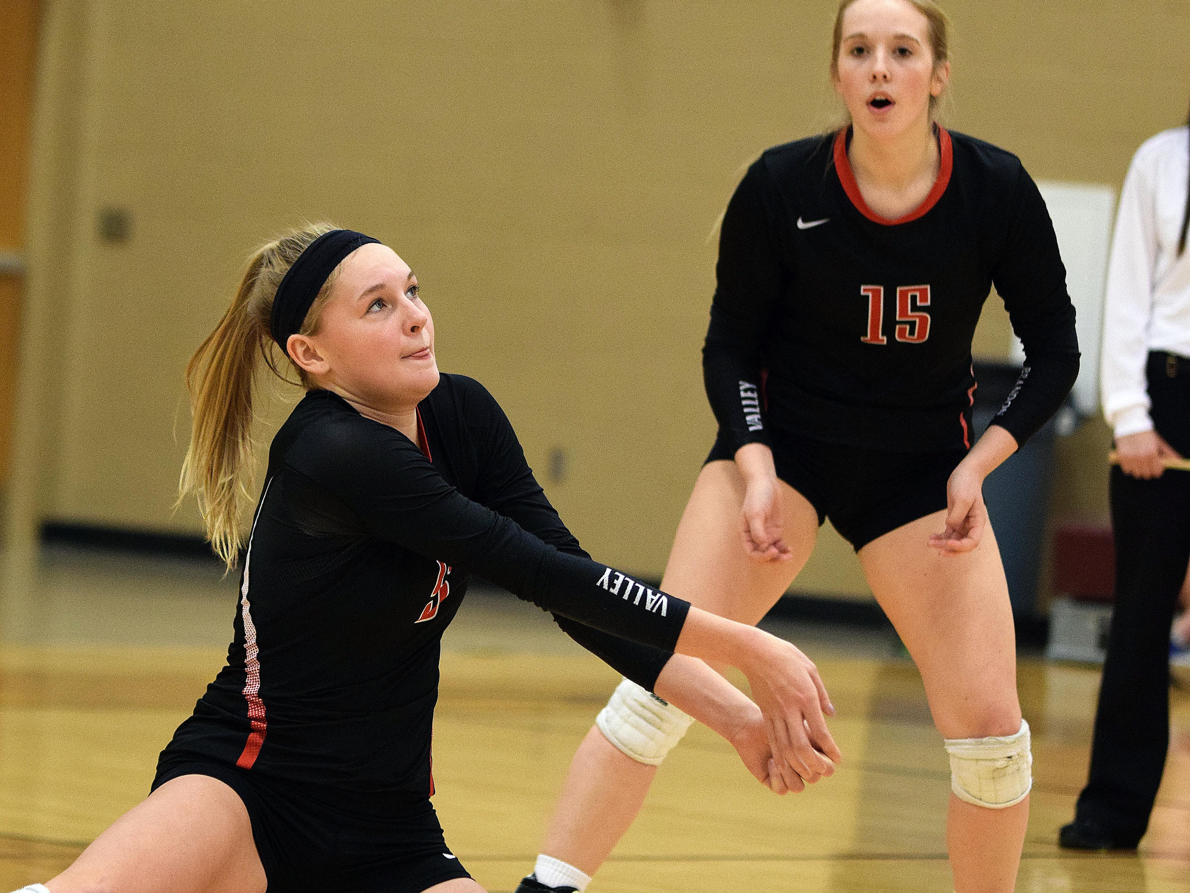 Hanna Jellema keeps the play alive Saturday night as teammate Brooke Etrheim looks on. Brandon Valley's 2016 volleyball season came to a close, as Harrisburg won the third-place District 2AA match by a 3-1 margin to advance in the post-season.