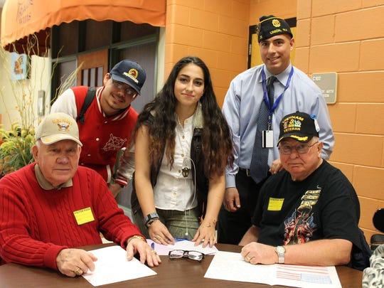 Back row, left to right, Somerset County Vocational-Technical High Schoolstudents Kevin Pidany of Bridgewater, Kristen Fernandez of South Bound Brook, and Social Studies Instructor and Army Veteran Ed M. Graf are shown with, seated, left to right, World War II Navy veteran John Shaud and Vietnam Army veteran Ed P. Graf during a recent program at the Bridgewater-based school.
