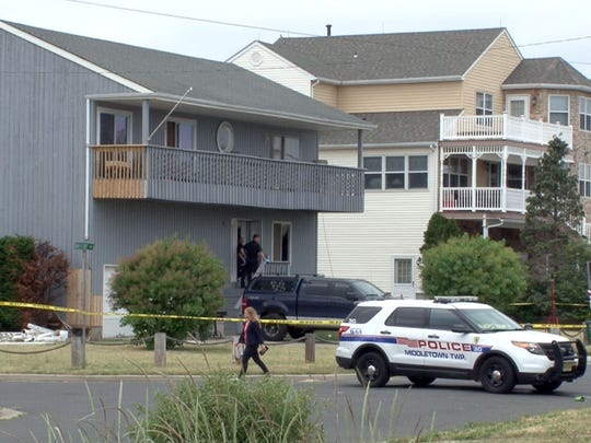 Investigators are shown outside 33 Bayview Parkway in the East Keansburg section of Middletown Township where a man holding his 13-month-old son hostage was shot and killed by police early Wednesday, May 27, 2015.