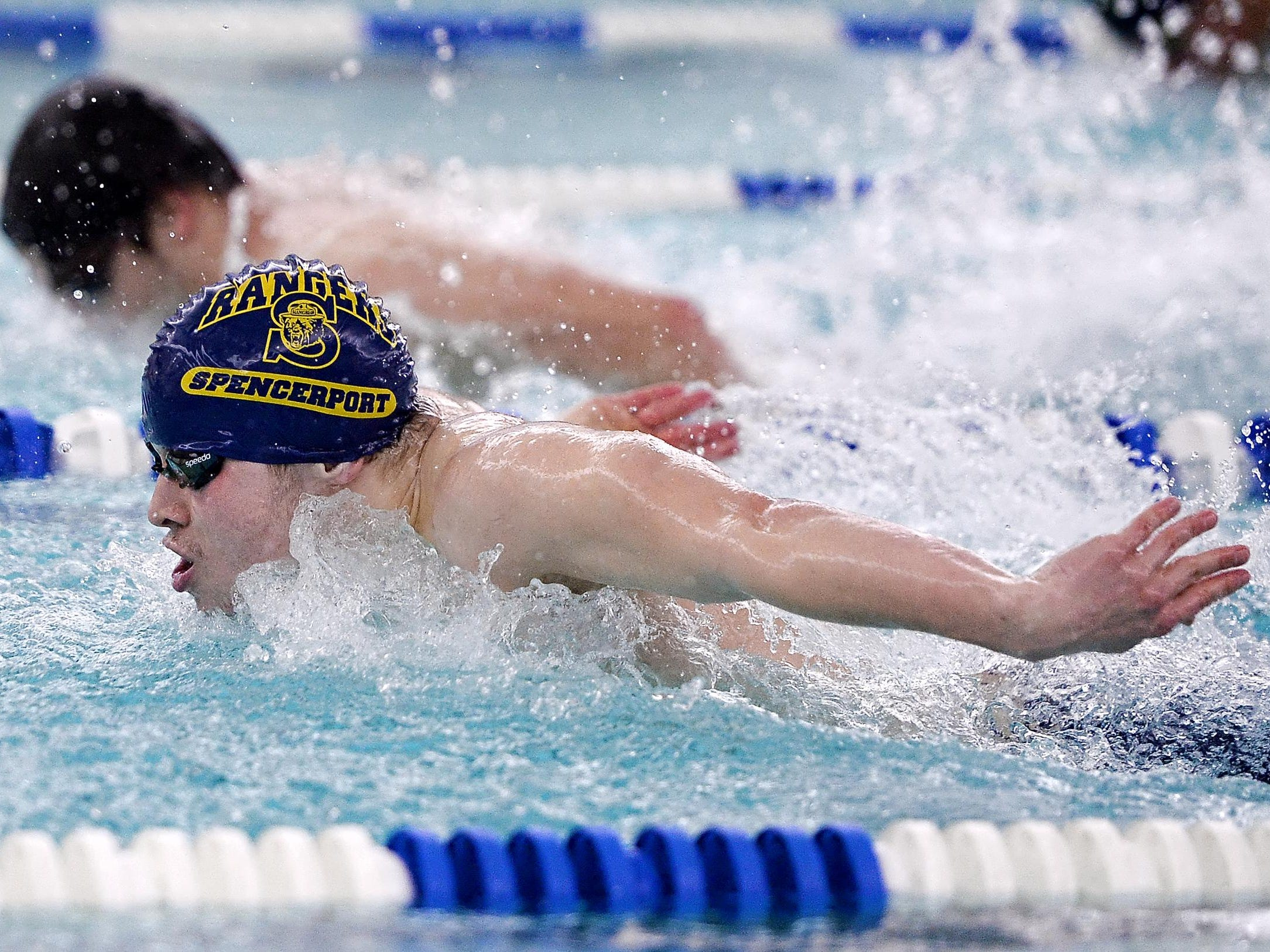 Spencerport's Max Wersinger, front, swims the 100-yard butterfly during a meet at Brockport High School on Thursday, Jan. 8, 2016. He qualified for states with a 53.41 win.