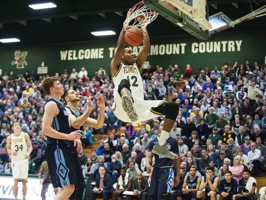 Vermont's Darren Payne (12) dunks the ball during the men's basketball game between the Maine Black Bears and the Vermont Catamounts at Patrick Gym on Wednesday night.