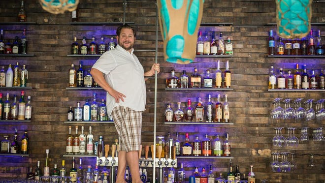 Matt Polley, owner of the Jungle, strikes a pose in the new barroom of the downtown spot. The Jungle incorporates the former Java Jungle coffeehouse and Jungle Vino wine bar.