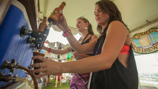 Deanna Shappy and Michelle Lawrence pour at the Vermont Pub and Brewery tent.