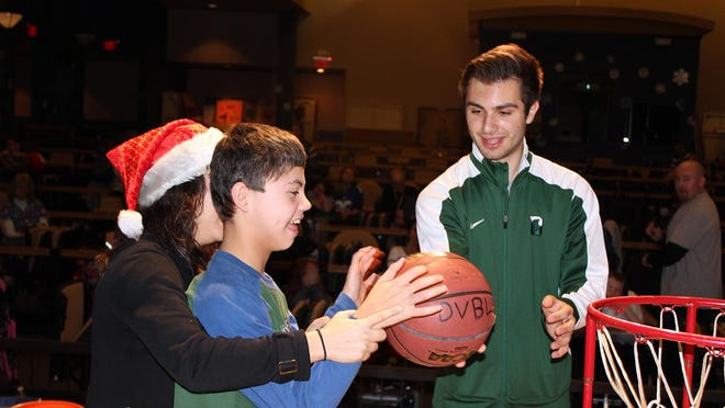 Dan Cimaglia, a resident of Basking Ridge, helps Matheny student Ryan O'Connor shoot a basket. Ryan is the son of John III and Debra O'Connor of Annandale.
