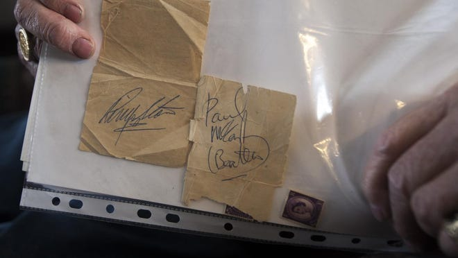 Joseph Gatt of New Windsor shows two receipts with autographs by Ringo Starr and Paul McCartney. Gatt was running an errand for his employer in his native England in the 1960s and staying at a fine hotel, when he crossed paths with the Beatles coming in the back door to their rooms.
