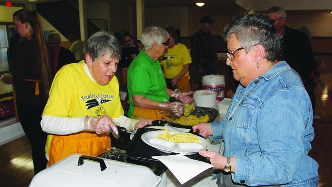 Volunteers scoop up chicken and noodles during the 2019 community event in Pratt which is a major fundraising effort for the Pratt Pilot Club International. This year's event, scheduled for March 23, has been postponed until April 22, 2020 because of coronavirus disease concerns.