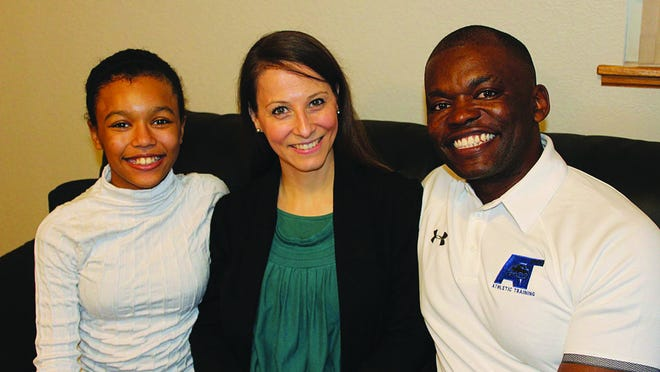 Ritchy Hitoto, right, along with his family, wife Naomi and daughter Keshia, is new to Pratt. He has been hired to lead the Athletic Training Department at Pratt Community College.