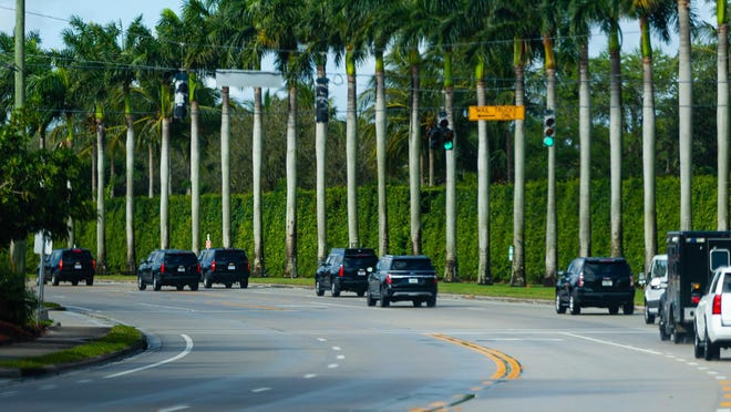 President Trump's motorcade heads west on Summit Boulevard on its way to Trump International Golf Course in West Palm Beach on Saturday, Feb. 15, 2020.