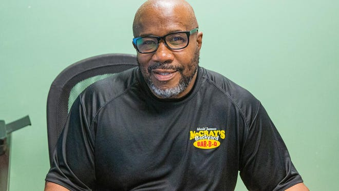 """Derrick McCray, community activist and owner of McCray's Backyard Bar-B-Q & Seafood. """"My father was on the front lines in rallies in the '60s and '70s trying to break down barriers,'' he said last week, """"and we're still fighting 40, 50 years later.''"""