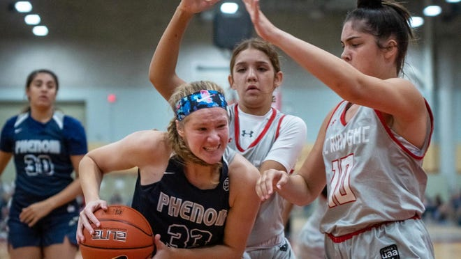 Grain Valley sophomore Grace Slaughter (33) battles for position in a game in the AAU Tournament of Champions last week in Des Moines, Iowa. Slaughter's 16U Phenom team went 6-1 in the tournament, including a win that included Blue Springs' Jada Williams.