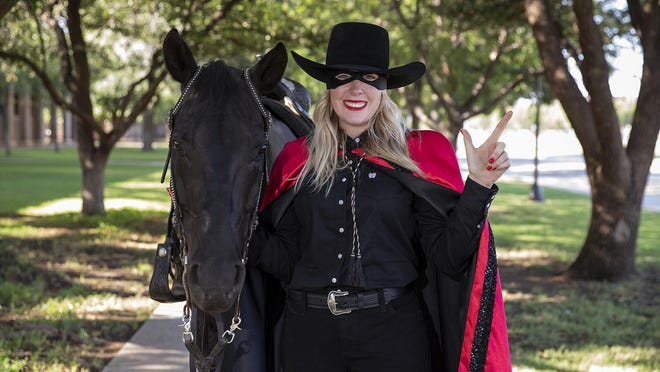 Cameron Hekkert, a fourth-year student in the College of Arts and Sciences and the Honors College, pictured here with Fearless Champion, will serve as the university's Masked Rider for the 2020-21 academic year.