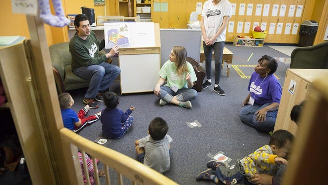 Teachers and children in the Early Head Start program participate in story time. Throughout the spring and summer, story time was conducted virtually to keep the children engaged and learning even while the center's physical location was closed.