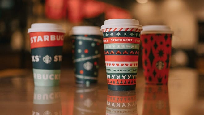 Starbucks red cups and holiday drinks are back starting Friday. {USA TODAY]