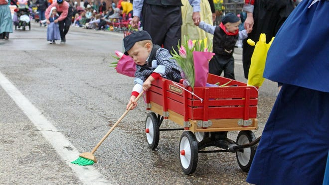 A child sweeps the streets during a Tulip Time parade in 2019. Tulip Time has recently announced there will be a festival in 2021.