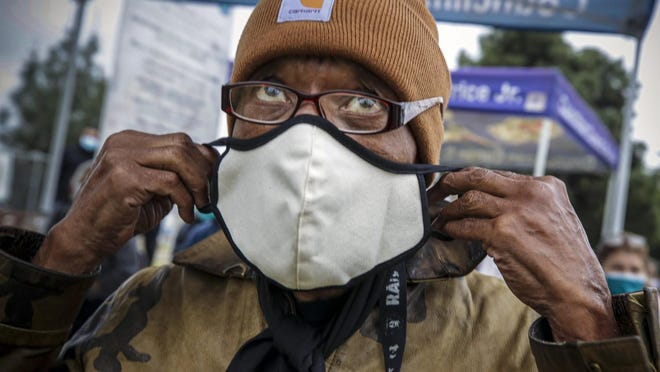 Los Angeles, CA - February 09: Lawrence Taylor, 77, waits for his turn to get COVID-19 vaccine at a mobile vaccination site launched by Los Angeles Councilman Curren Price Jr. at South Park Recreation Center on Tuesday, Feb. 9, 2021 in Los Angeles, CA.(Irfan Khan / Los Angeles Times/TNS)