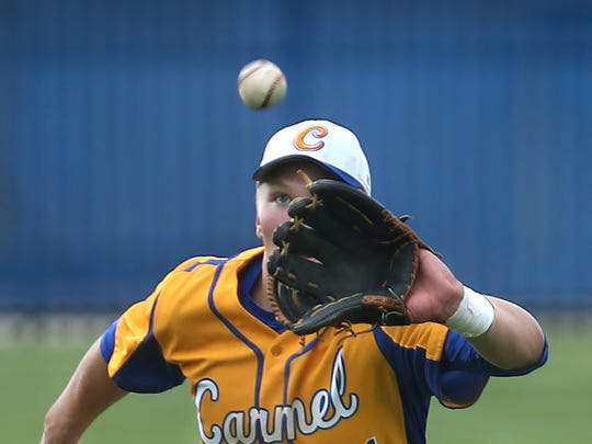 FILE – Carmel third baseman Jack Van Remortel makes an infield catch.