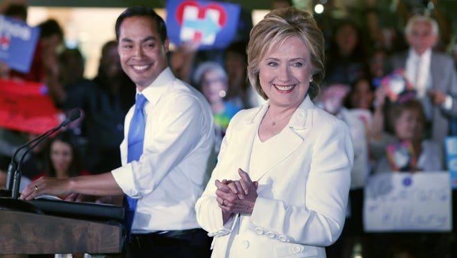 """Secretary of Housing and Urban Development Julian Castro introduces Democratic presidential candidate Hillary Clinton at a """"Latinos for Hillary"""" grassroots event October 15, 2015 in San Antonio, Texas."""