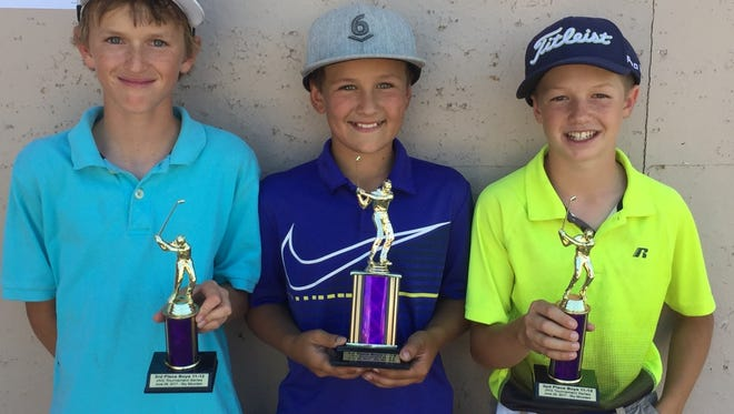 Boston Dixon (center) and Hunter Clark (right) and Michael Stirland pose for a picture after finishing in the top 3 in the boys' 11-12 JAG division at Sky Mountain on Thursday.