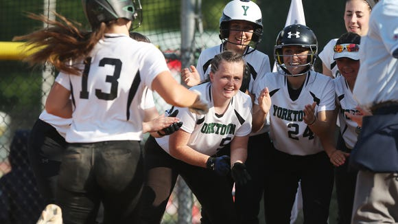 From left, Yorktown's  Brianna Buck (13) is greeted by teammates after her two-run homer against Suffern during girls softball playoff action at Yorktown High School May 23, 2018. Yorktown won the game 4-1.