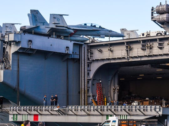 An F/A-18 Super Hornet aircraft can be seen on the deck of the Nimitz-class carrier, USS Theodore Roosevelt, while docked at the Kilo Wharf on Naval Base Guam in Sumay on Tuesday, Oct. 31, 2017. The carrier, along with the Carrier Air Wing 17 and embarked Destroyer Squadron 23, departed San Diego for a regularly scheduled deployment to the western Pacific. The Arleigh Burke-class guided-missile destroyers, USS Preble and the USS Halsey, are also visiting Guam as they sail with the USS Theodore Roosevelt Carrier Strike Group Nine.