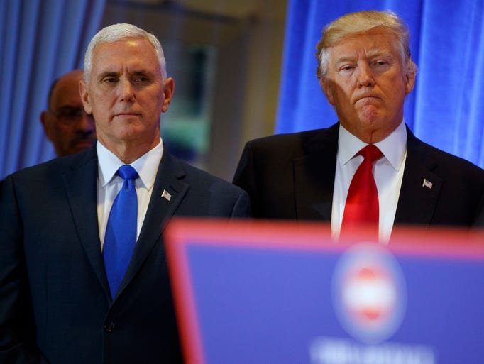 Trump stands with Pence before his news conference